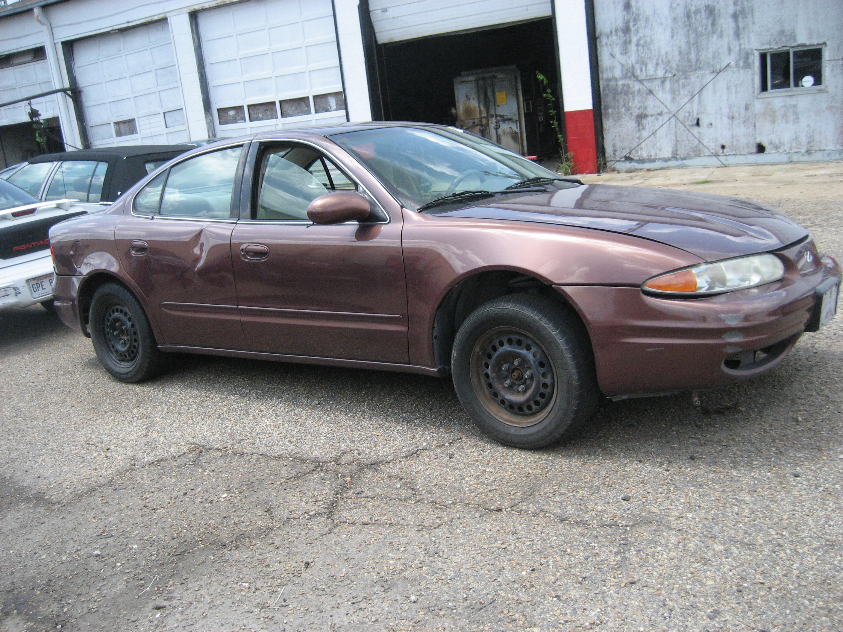 sold cheap 1999 maroon oldsmobile alero 1250. Black Bedroom Furniture Sets. Home Design Ideas